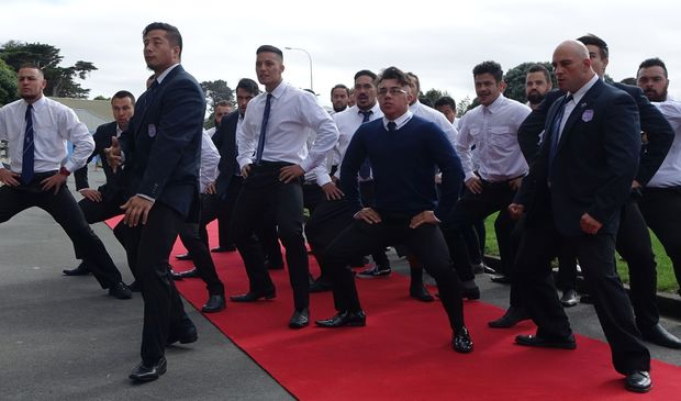 Members of the Northern United Rugby Club perform a haka at the ceremony.