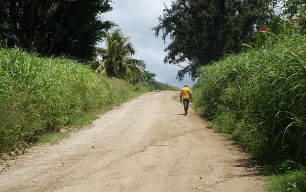 A man walks along a road near Lenakel, on the Vanuatu island of Tanna.