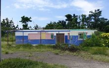 The Lenakel Cooperative Society building, which was damaged by cyclone Pam in Vanuatu, lies abandoned a year later.