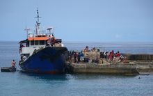 An inter-island ferry loads in the Vanuatu town of Lenakel, Tanna, for the return journey to the capital, Port Vila.