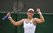 Marina Erakovic celebrates beating Peng Shuai during their women's singles match during the 2013 Wimbledon Championships.