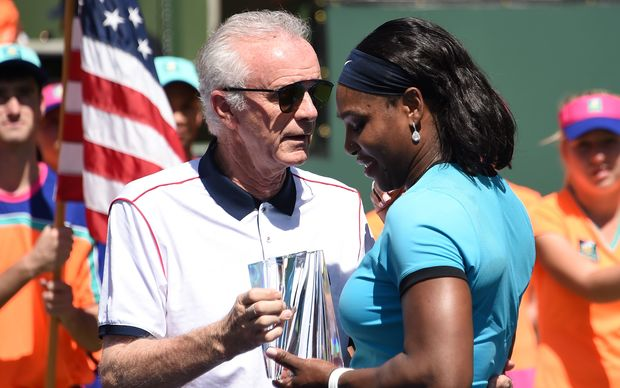 Raymond Moore presents the second place trophy to Serena Williams after the women's final of the BNP Paribas Open in March 2016.
