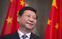 Chinese president Xi Jinping is framed by national flags during an overseas visit, to Berlin on 28 March 2014.