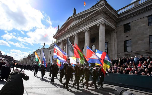 Members of the Irish army march past the General Post Office, the scene of the 1916 Easter Rising