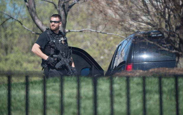 A US Secret Service agent stands guard at the White House after it was put into lockdown