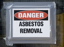A file photo of a sign warning about asbestos removal