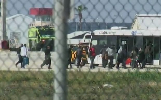 A screenshot from the BBC shows passengers leaving the aircraft in Larnaca.