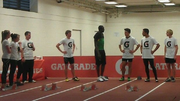 Bolt shares some tips with promising sprinters at the Millennium Institute.