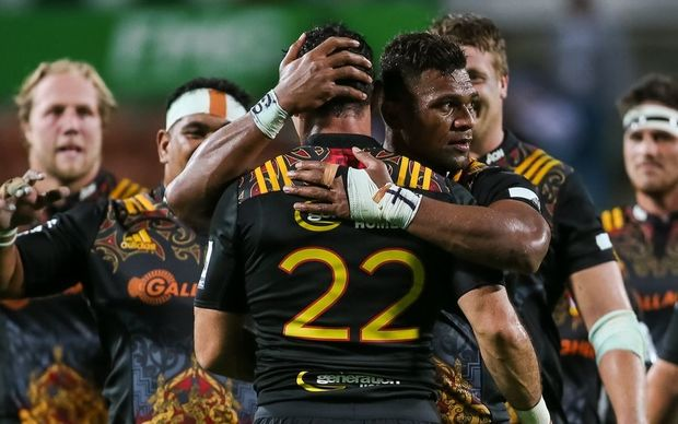 Chiefs centre Seta Tamanivalu hugs Chiefs replacement Stephen Donald after his successful shot at goal during their Super Rugby game vs Western Force at FMG Stadium, Hamilton, on Saturday 26 March 2016.
