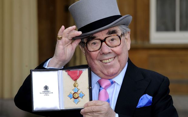 Ronnie Corbett poses with his medal after he received the CBE honour from the Queen in 2012