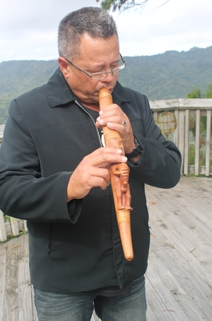A photo of Riki Bennett playing a putorino.