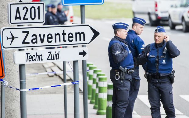 Police officers at the entrance of Brussels Airport, in Zaventem, Wednesday