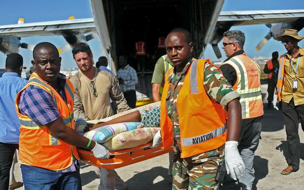 UN staff medics help wounded civilians at Mogadishu airport in Somali after a bombing by al Shabaab. 29  February, 2016.