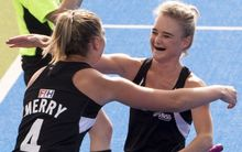 Olivia Merry and Charlotte Harrison celebrate the goal.