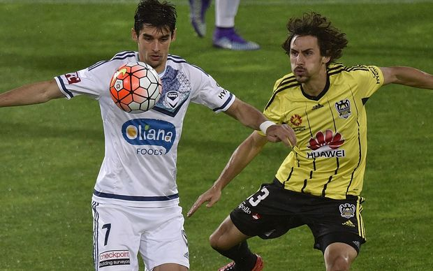 The Victory's Gui Finkler (L) takes a pass in front of Albert Riera.