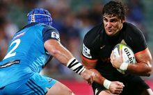Tomas Lezana of the Jaguares charges James Parsons.