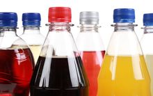 Bottles of soft drinks, isolated on a white background. (file photo)