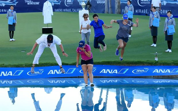 Lydia Ko celebrates her win at the ANA Inspiration with the winner's jump in the 18th lake alongside her caddie, mother and sister.