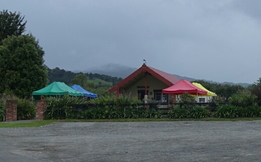 Colourful tents in front of the wharenui at Hiruharama Marae near Ruatoria, as it prepares to hold a tangi for Whairiri Ngata.