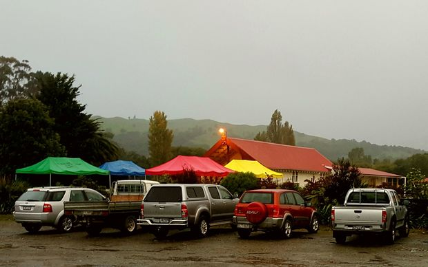 Colourful tents in front of the wharenui at Hiruharama Marae near Ruatorea, as it prepares to hold a tangi for Whairiri Ngata.