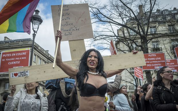 Sex Workers and supporters protest as French lawmakers take part in a final debate on a bill that would make it illegal to pay for sex.
