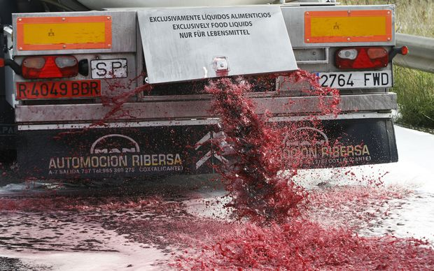 Wine flows from the tap of a Spanish truck's tanker on 4 April in France near the Spanish border during a demonstration of French winemakers against southern countries' wine imports.
