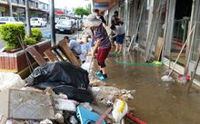 Nadi shopkeepers clean up outside their shops after flooding this week