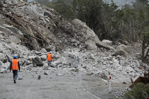 The scene on the Milford road after a giant boulder was blasted apart.