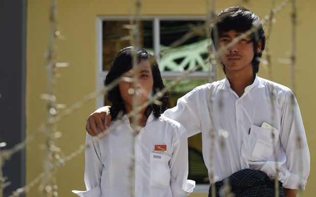 Detained Myanmar physics student Myo Htet Paing, 20, and tenth-grade student Lwin Ko Ko Aung, 20, outside the court house in Tharrawady town before their trial. The pair are among 40 students facing charges over education reform protests last March. They face up to ten years in jail if convicted.