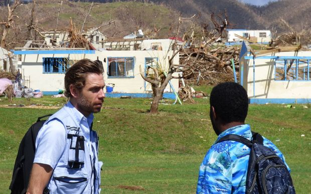 The UN's Sune Gudnitz (L) touring devastated areas of Fiji after Cyclone Winston
