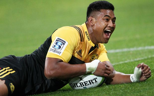 Julian Savea celebrates his hat-trick.