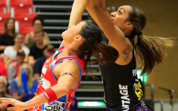 Magic's Malia Paseka competes for the ball with Swifts' Sharni Layton