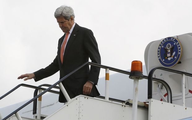 US Secretary of State John Kerry disembarks from his aircraft in a surprise visit to Afghanistan.