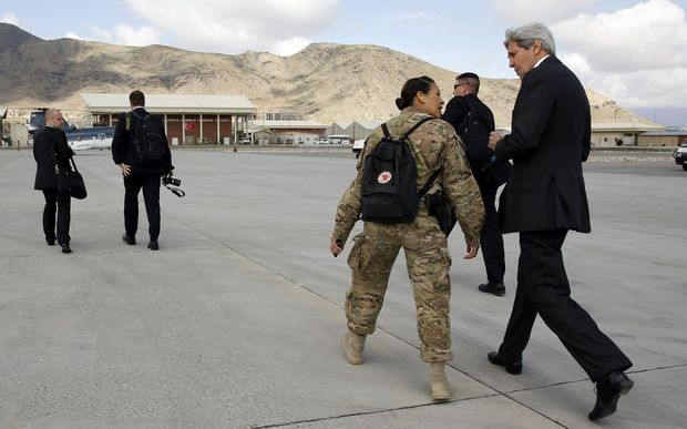 US Secretary of State John Kerry with officials in Afghanistan.