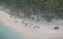 Stranded sailors on a deserted Pacific island used palm fronds to spell 'help'.