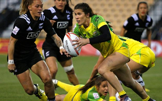 Australia's Charlotte Caslick breaks New Zealand's defence.