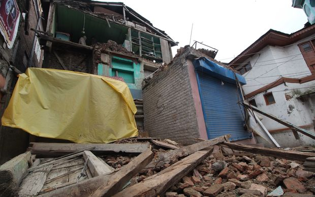 A residential house shows damage in a powerful earthquake in Srinagar, the summer capital of Indian-controlled Kashmir.