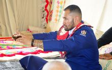 Sergeant Sanalio Kaihau drinks a bowl of kava at a ceremony for his appointment as police Pacific Liason Coordinator for Auckland's Waitematā district.