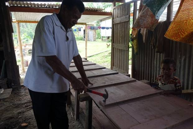 Nawaisomo village chief Ratu Waisea Drakusiwale is building a new river boat. His last one was washed away in floods