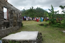 Navakawau villagers gather to watch aid being delivered