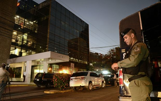 Police stand guard outside the Mossack Fonseca law firm offices in Panama City during the raid.