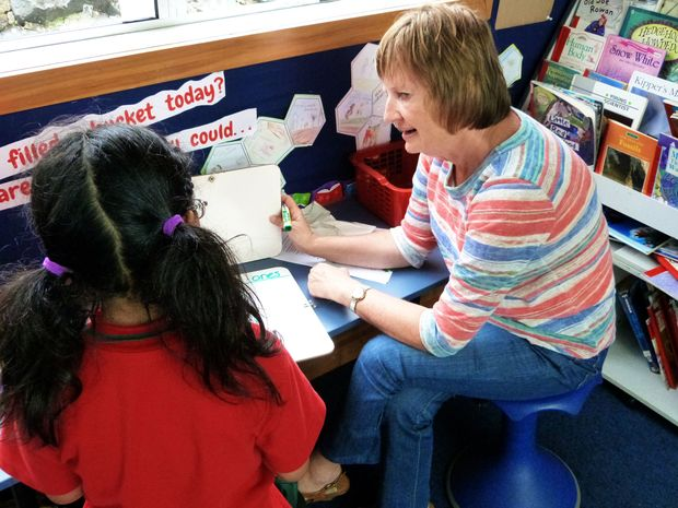 Sunnydene Special School outreach teacher Glennis Keown works with a child at Newmarket School in Auckland