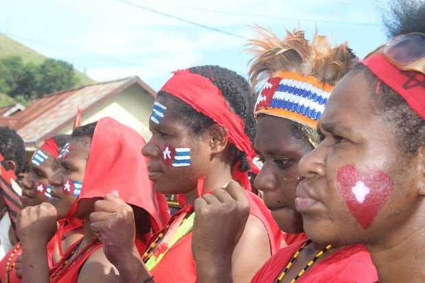 West Papuans demonstrating support for the Liberation Movement had the Papuan Morning Star flag emblazoned on body and garb.