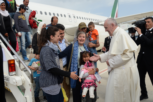 Pope Francis welcomes a group of Syrian refugees after landing in Rome following a visit at the Moria refugee camp.