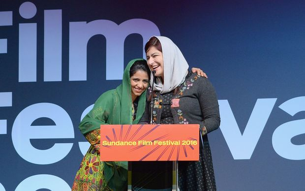 Sonita Alizadeh and Rokhsareh Ghaemmaghami accept the Audience Award for a world cinema documentary at the Sundance Film Festival Awards.
