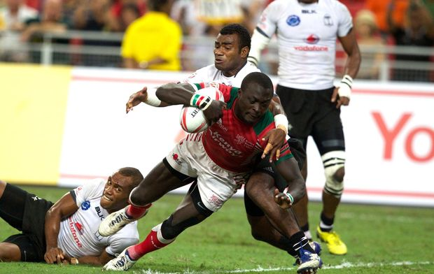 Man of the match Collins Injera scores in Kenya's Cup final win against Fiji.