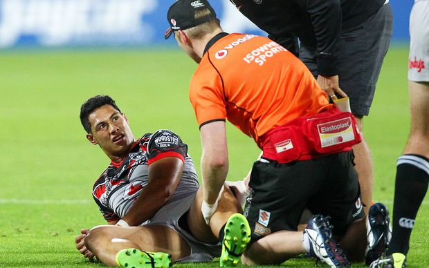 Roger Tuivasa-Sheck receives treatment for his injured knee during the Warriors match against the Bulldogs in Wellington.