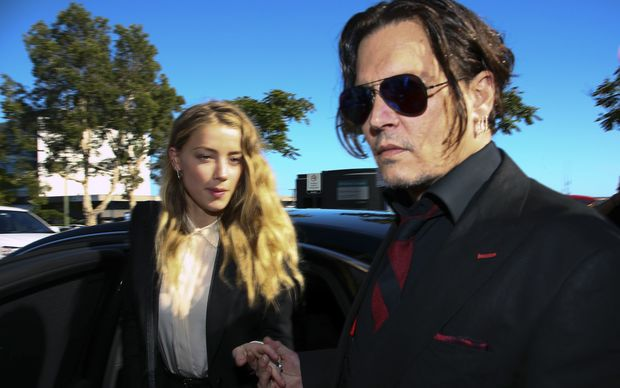 Johnny Depp and Amber Heard arrive at a court on the Gold Coast.