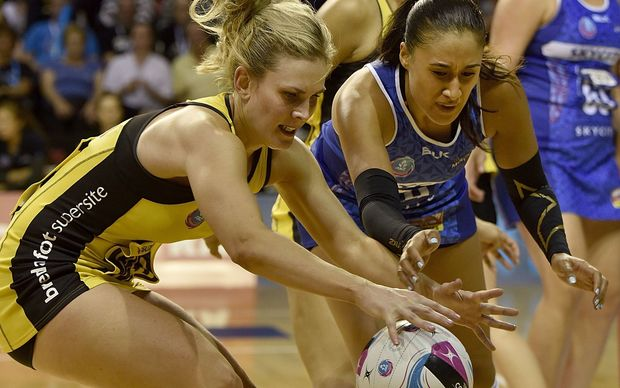 Maria Tutaia (right) and Jacinta Messer battle for possession.
