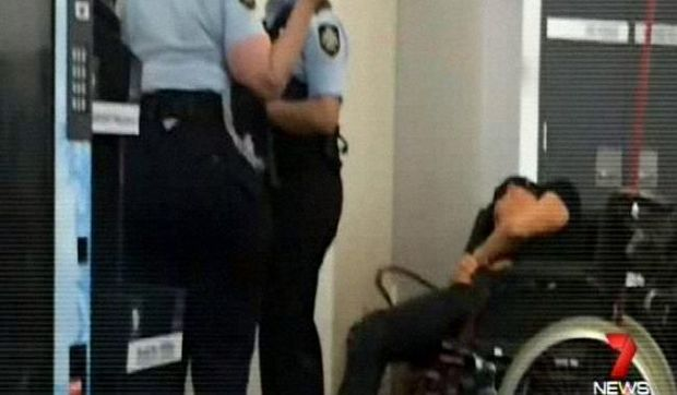 Police attempt to question Grant Hackett at Melbourne airport.
